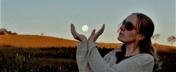 Full moon, two hands